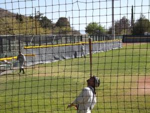 Player for Glendale, AZ vintage baseball team balances bat on his nose