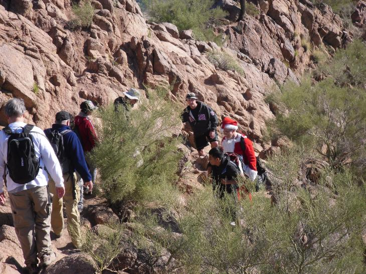 Uphill and downhill hikers often negotiate tight spaces on the narrow trail..