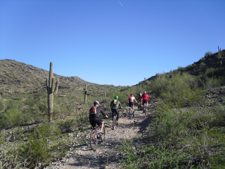 Not far after this photo was taken the mountain bikers dismounted as the trail got too steep to ride up.